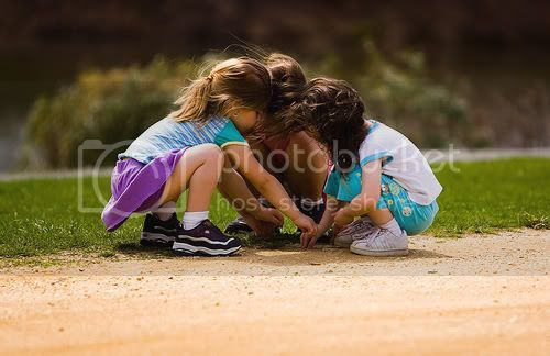 three girls playing in the dirt