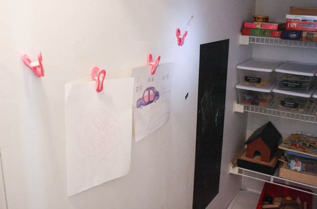 Twine and clothespins make a simple art gallery.