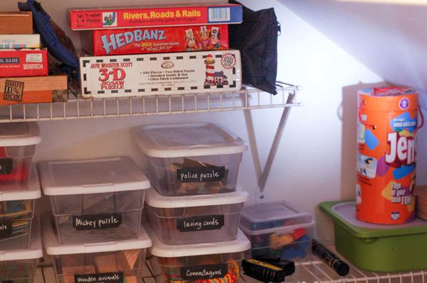 Turn the extra space of a closet under the stairs into toy storage.
