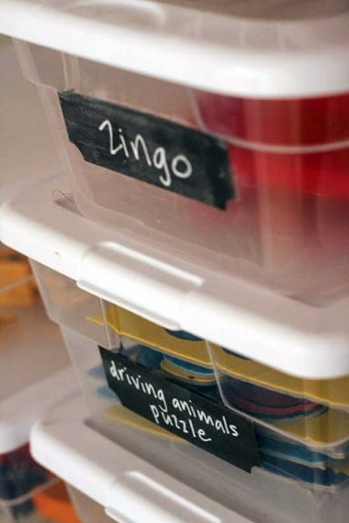 Add chalkboard labels to plastic boxes for reusable toy containers.