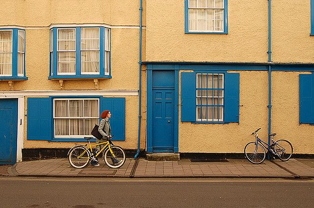 woman walking a bike
